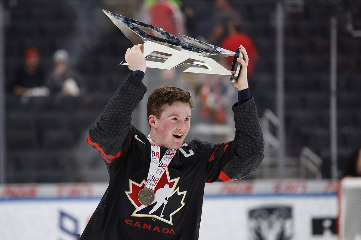 Canada's Alexis Lafreniere (11) hoists the Hlinka Gretzky Cup following the Hlinka Gretzky Cup gold medal game against Sweden, in Edmonton on August 11, 2018. Lafreniere is not only projected to be first overall pick at the 2020 NHL draft, the event will be held at the Bell Centre in Montreal — about a 40-minute drive from his hometown of Saint-Eustache. THE CANADIAN PRESS/Codie McLachlan