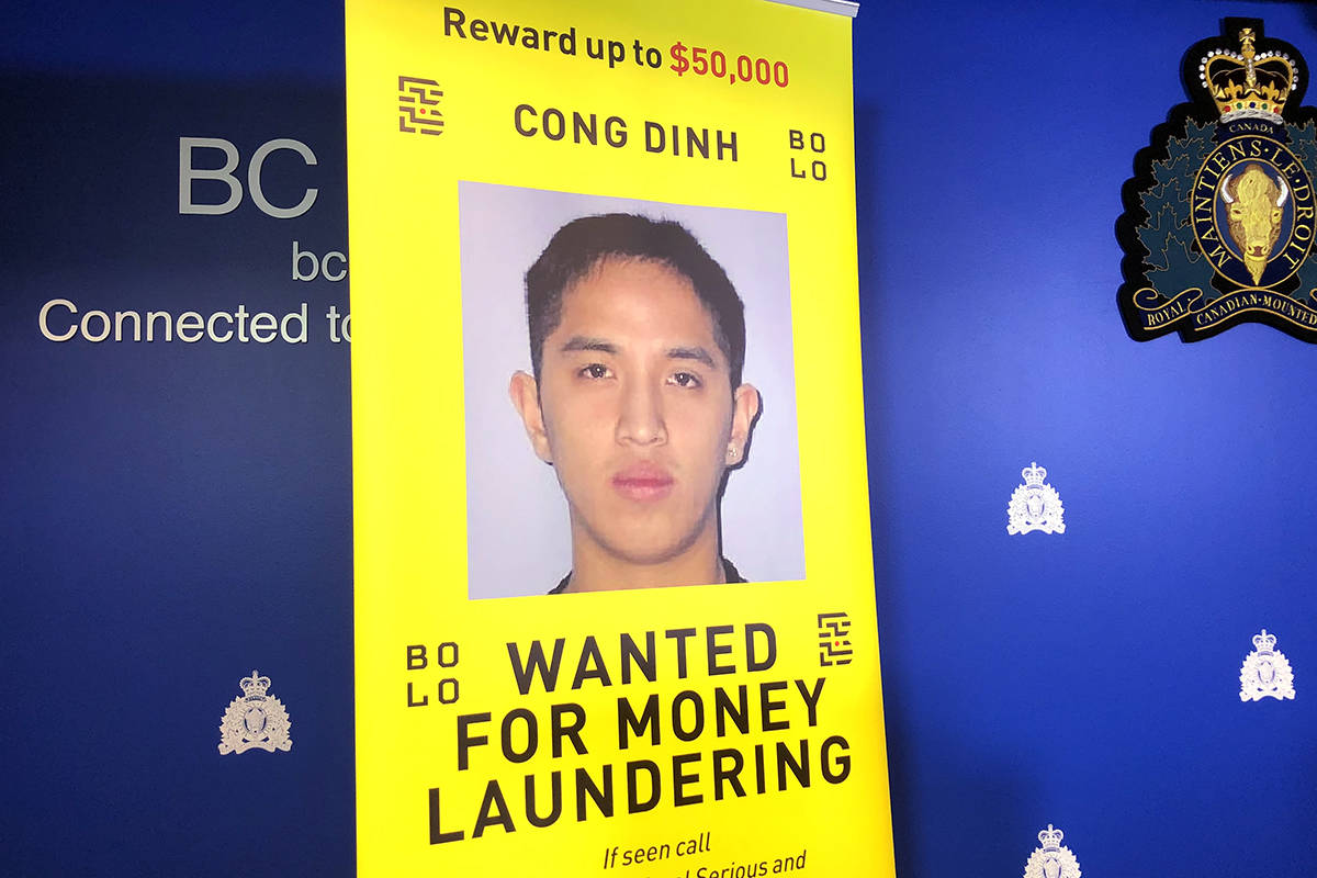 Cong Dinh, 32, is shown here on a mugshot at RCMP E-Division headquarters on Tuesday, Dec. 3, 2019. Dinh is wanted on charges of money laundering and drug trafficking. Authorities believe he is in Vietnam and a $50,000 reward is being offered for information leading to his arrest. (Katya Slepian/Black Press Media)
