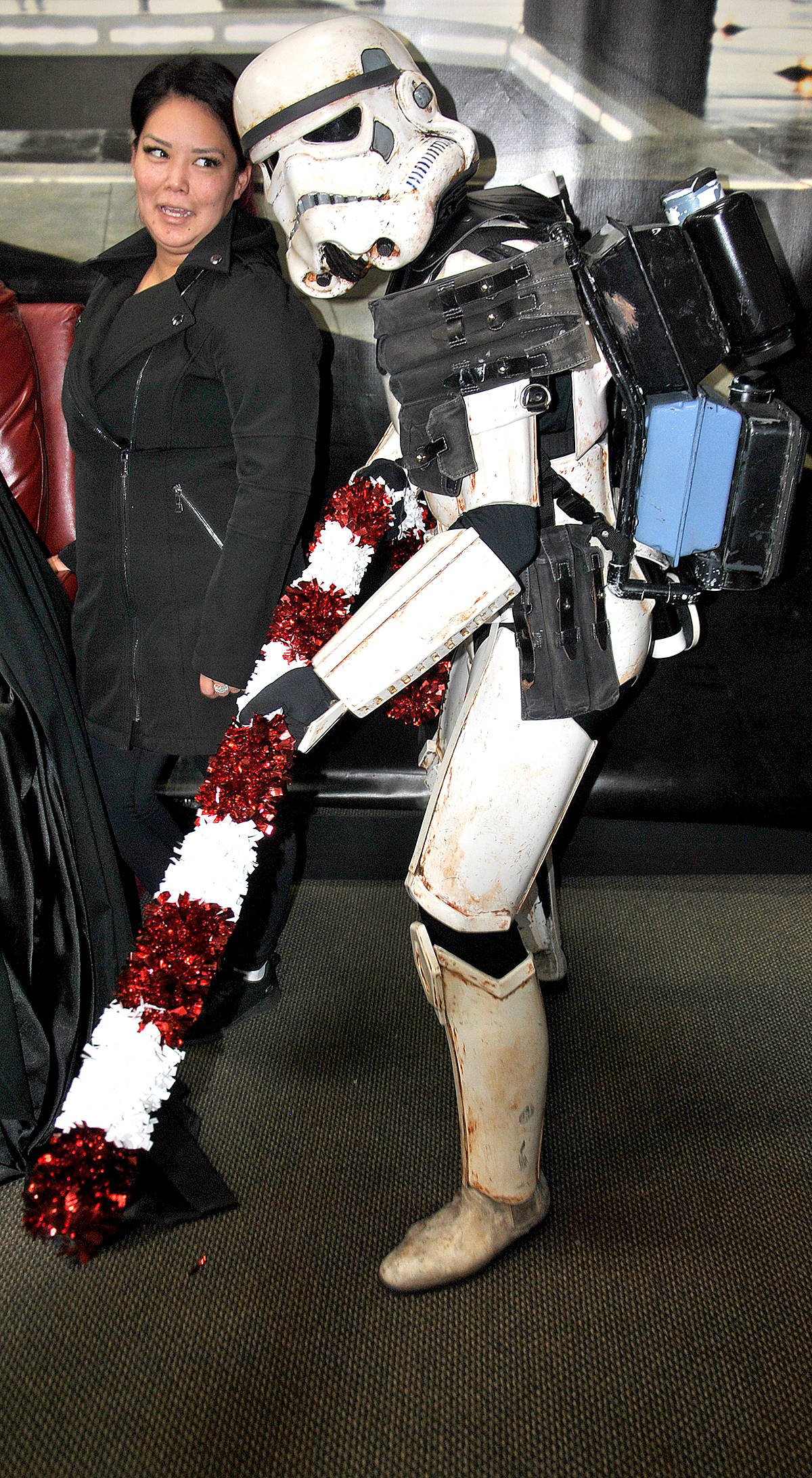 While many of the kids and adults alike enjoyed having a picture taken with the frozen-in-carbonite Han Solo, or with Darth and R2, this mom posed with a candy-cane wielding Stormtrooper. (Roxanne Hooper/Langley Advance Times)