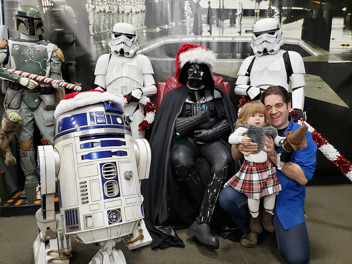 Toy Trader owner Matthew Purdy, and his successor, young Kamaria, had their picture taken with Darth, R2, and the troopers on Sunday. (Special to the Langley Advance Times)