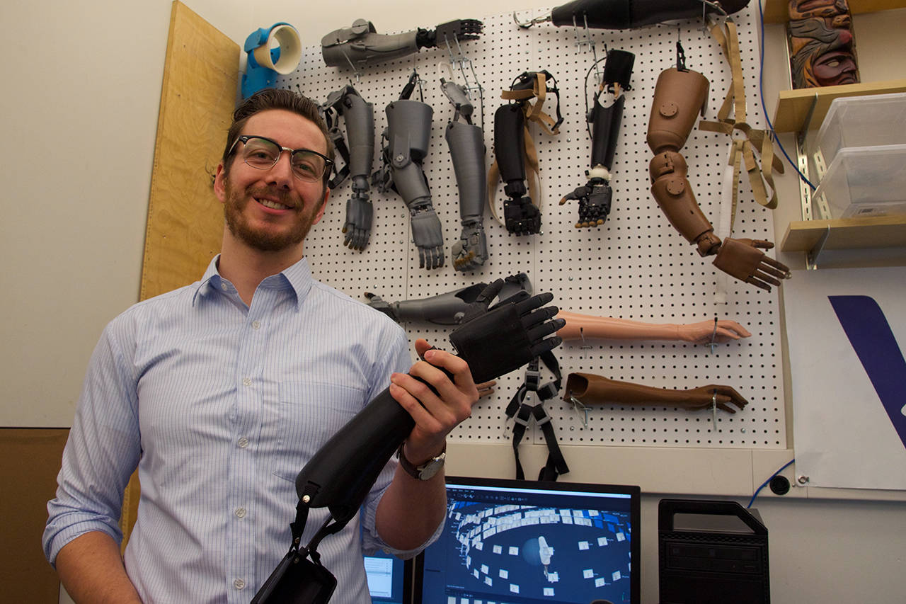 Dec. 3, 2019 – Michael Peirone, COO of the Victoria Hand Project, holds up a 3D-printed hand, which a new grant will fund for dispersal throughout North America. (Nicole Crescenzi/News Staff)