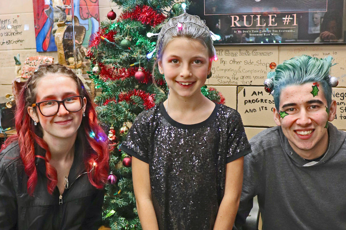 Langley residents Alexia Ficzay (left) and Scott Farynuk (right) showcased holiday-inspired hairstyles by Aldergrove Secondary's student stylist Marie Glynn on Nov. 28. (Sarah Grochowski photo)