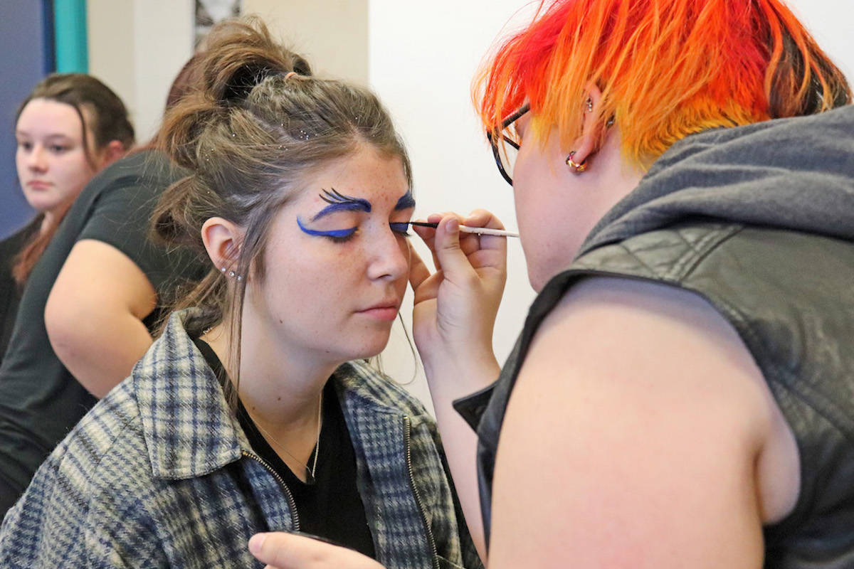Alumni Samantha Harder returned for the second year to do the runway flare makeup for all of the hair models. (Sarah Grochowski photo)