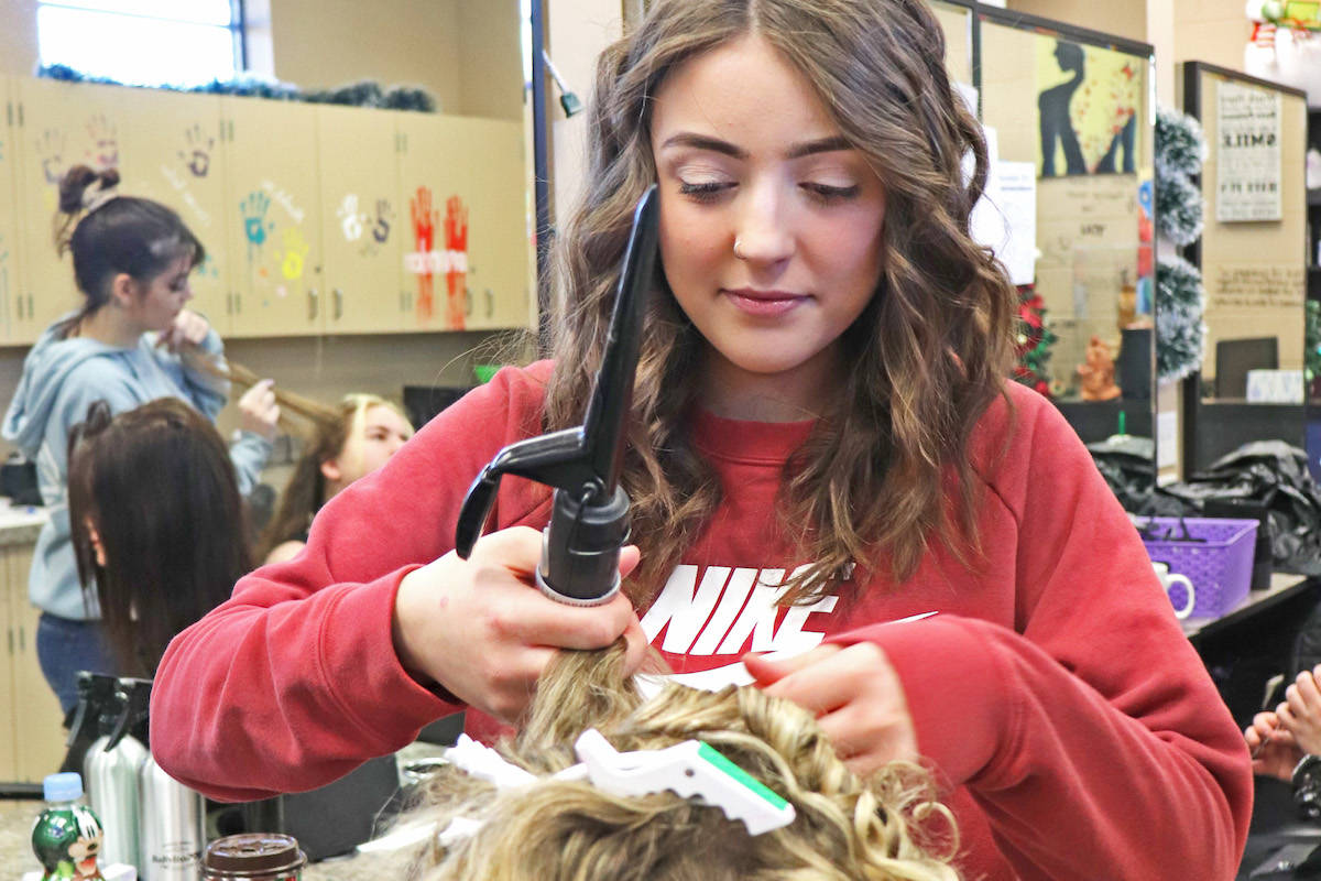 Student stylist Faith Pederson (below) executed a head of curls. (Sarah Grochowski photo)