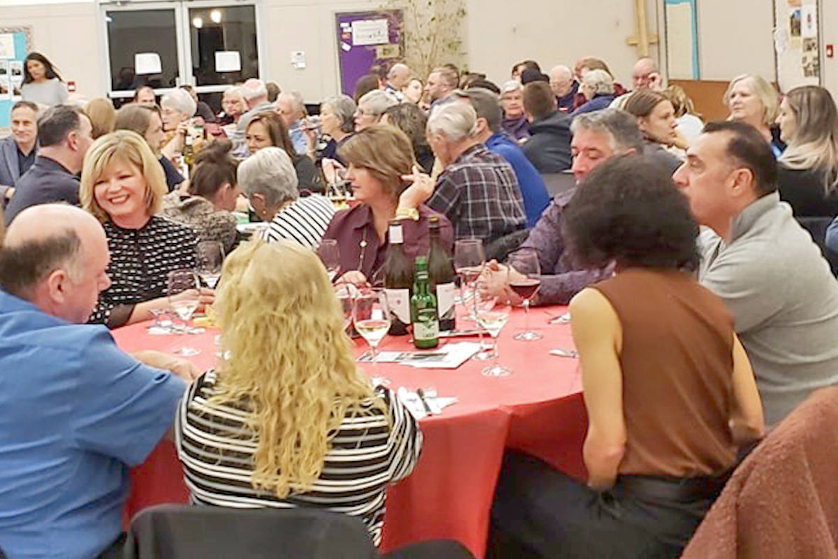 Aldergrove Rotary Club carries on the three-year tradition of gourmet food and lively bidding