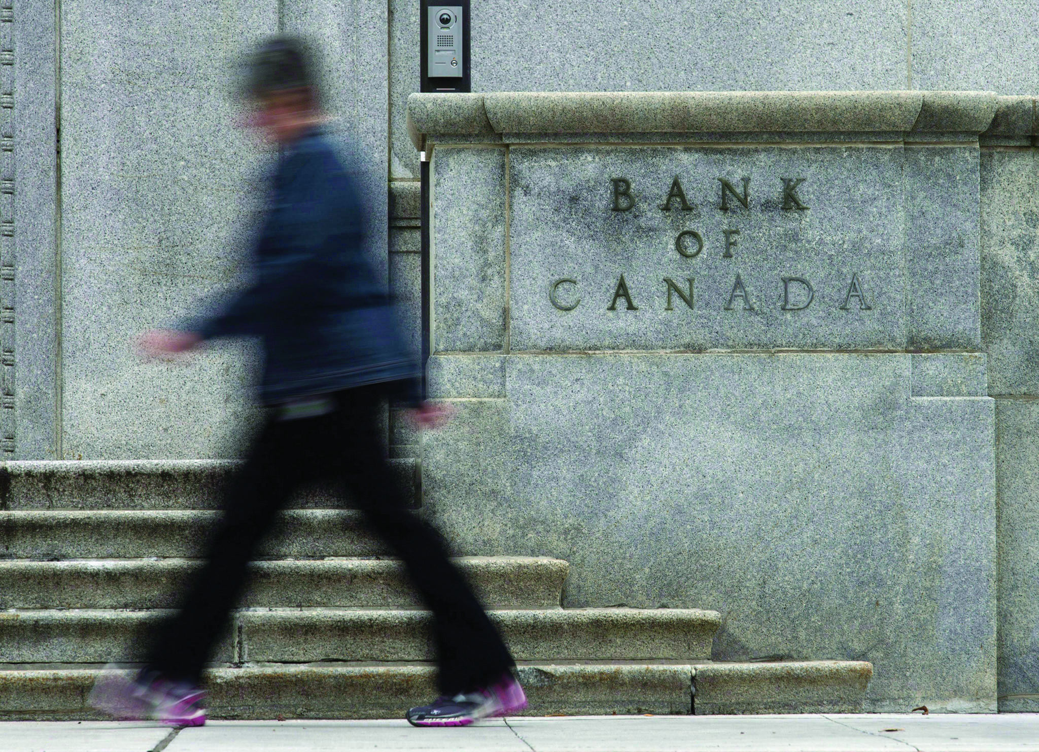 A woman walks past the Bank of Canada Wednesday September 6, 2017 in Ottawa. THE CANADIAN PRESS/Adrian Wyld