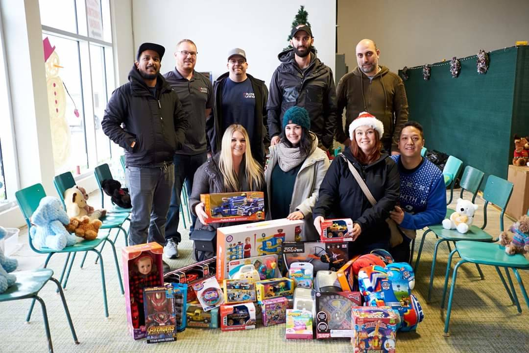 European car enthusiasts are donating toys and $2,000 to the Langley Christmas Bureau. (Alora Vandenberg/Special to the Langley Advance Times)