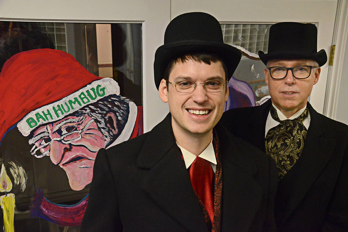 """Kyle Murray, a.k.a. Bob Cratchit (left) and Wayne Kuyer as miser Jacob Marley will be heading out again to spread some """"Bah! Humbug!"""" and raise money for B.C. charities serving the less fortunate starting next week. (Matthew Claxton/Langley Advance Times)"""