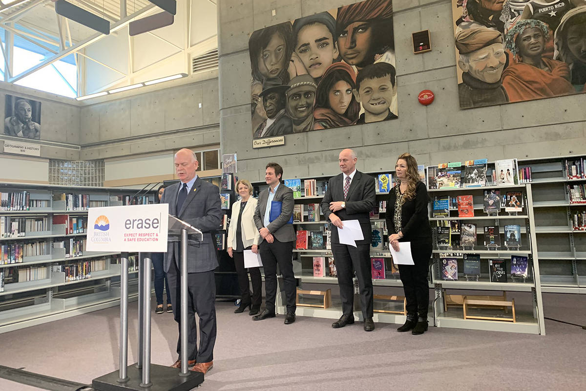 Surrey MLA Garry Begg speaks to a crowd at North Surrey Secondary School on Dec. 5 as the provincial government announces more funding for gang prevention programming. (Photo: Twitter@RachnaSinghNDP)