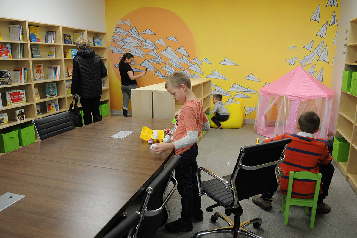 People tour the new Pacific Autism Family Network location during its grand opening in Chilliwack on Tuesday. (Jenna Hauck/ The Progress)