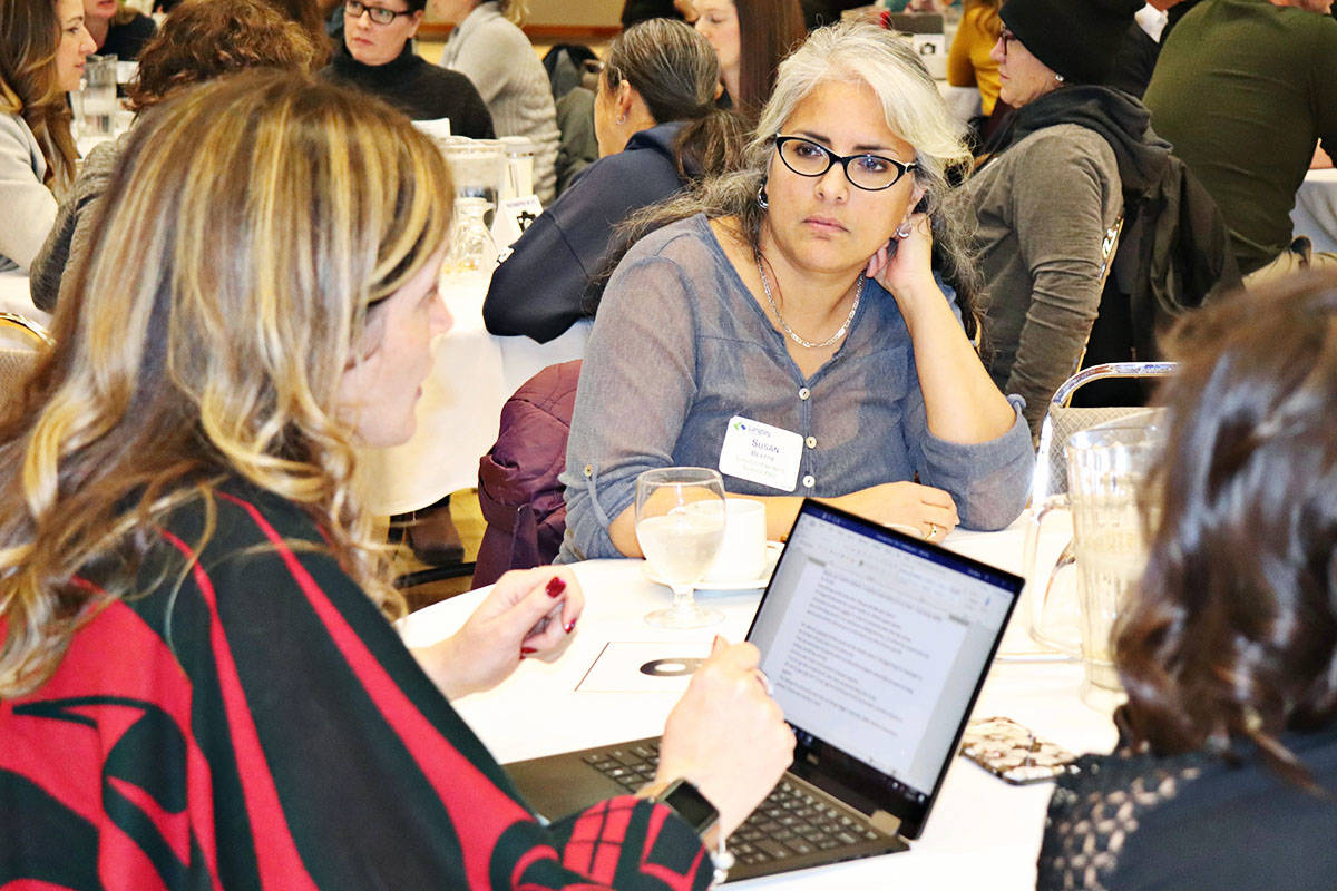 H.D. Stafford Middle School vice principal Elise Rehnb (left) and Susan Beattie, Langley Fine Arts School Parent Advisory Council (right) were among those who brainstormed ideas to help tackle youth issues. (Joanne Abshire/Langley School District)