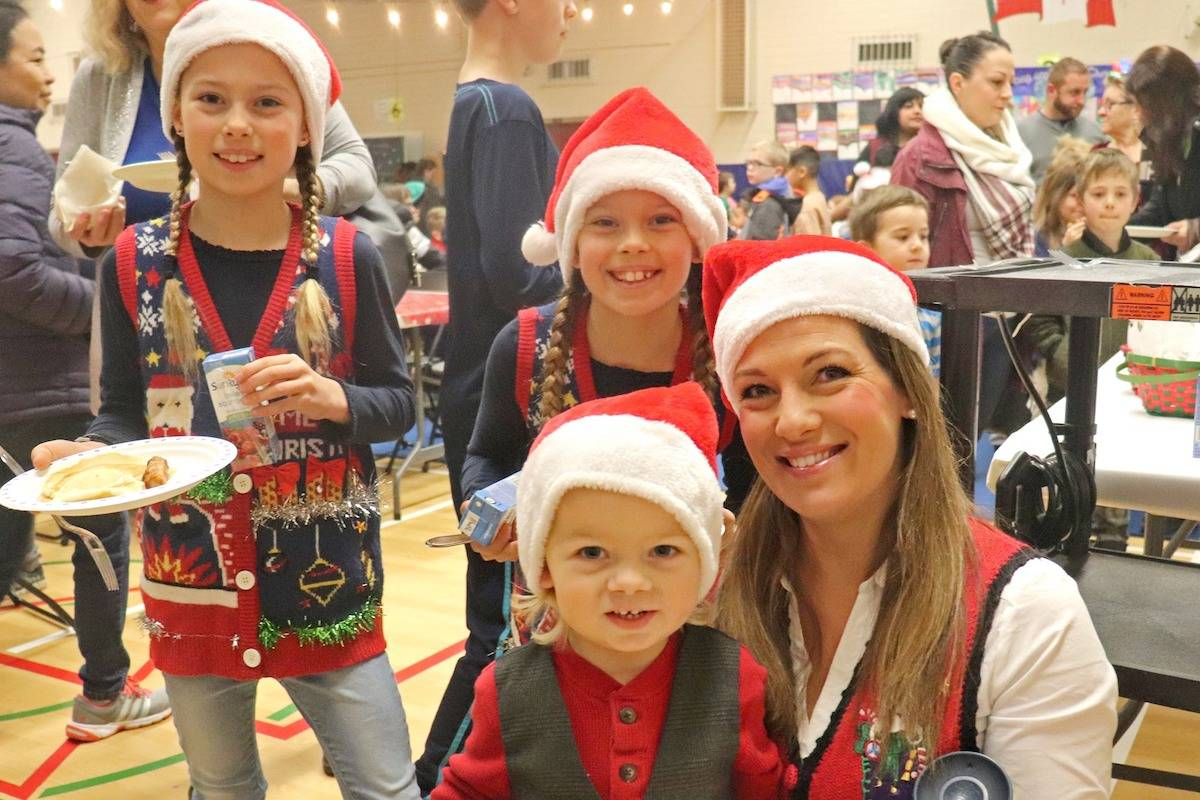 The Wejr family was one of the hundreds of Aldergrove families who took part in this year's Santa Breakfast at Shortreed Elementary School. (Sarah Grochowski photo)