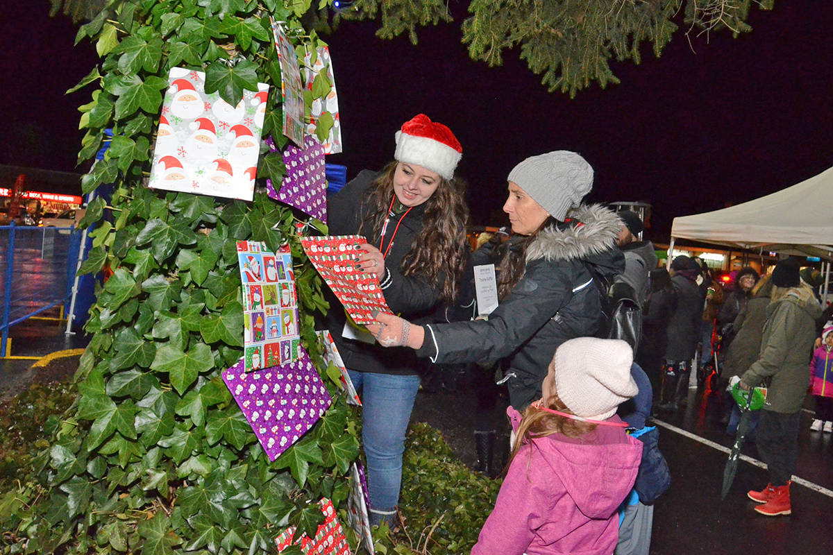New this year was a raffle for Brookswood Night of Lights. Winners picked certificates off the massive evergreen tree in the Brookswood Plaza Mall for prizes such as grocery gift cards, sports tickets, and more. Funds from the raffle help with costs of the free family event. (Heather Colpitts/Langley Advance Times)