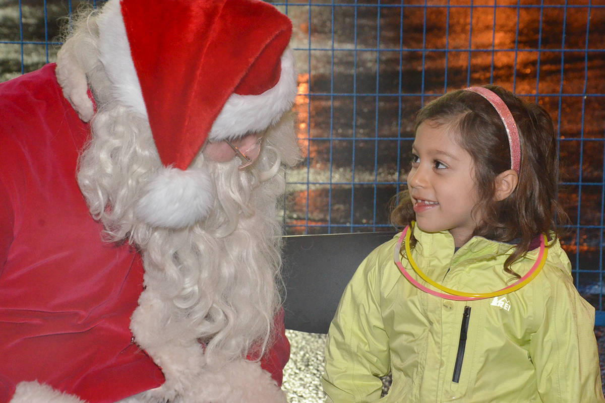 One of the highlights for many of the kids on Friday evening was one-on-one time with Santa Claus at Brookswood Night of Lights. (Heather Colpitts/Langley Advance Times)