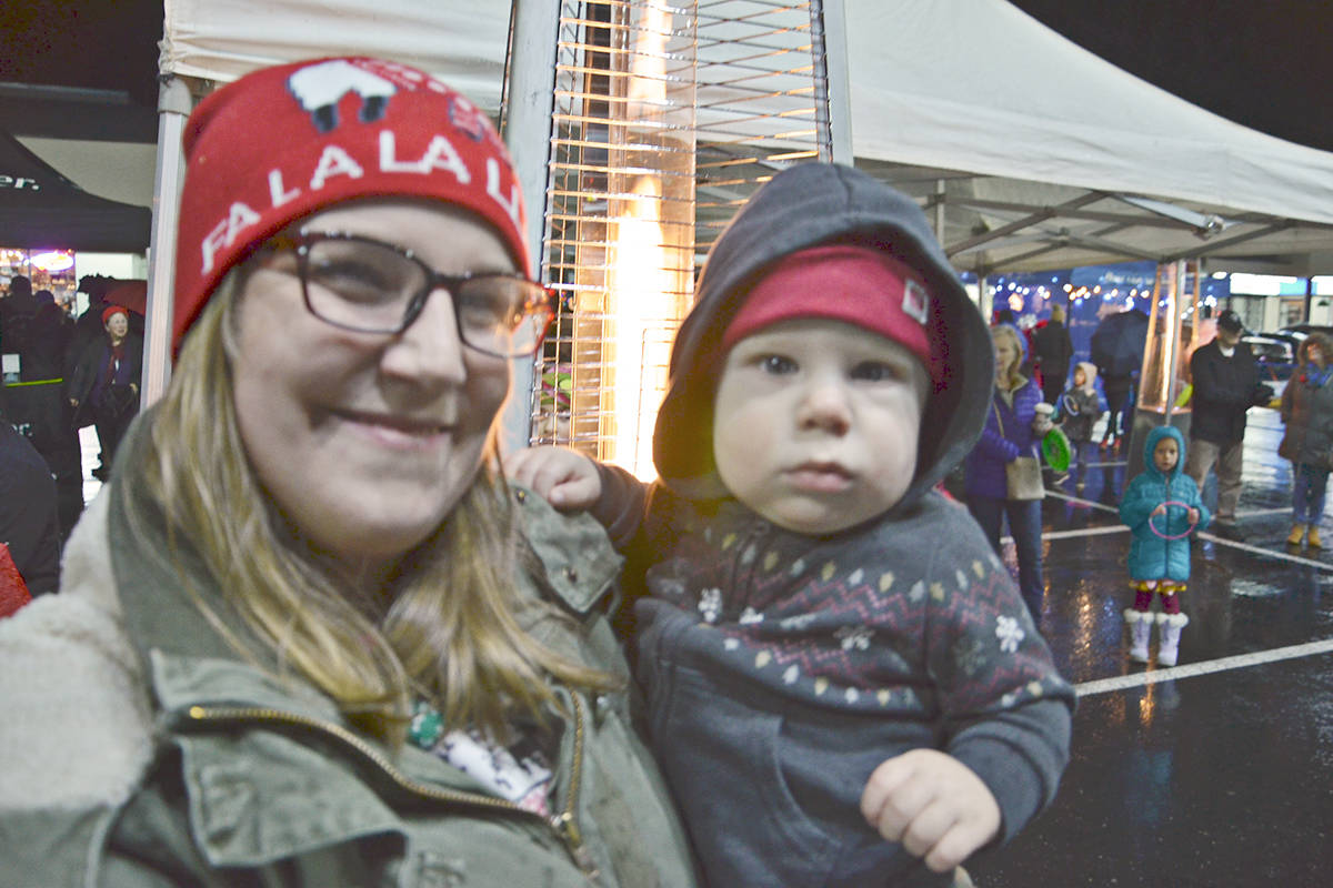 Chelsea Wright and 10-month-old Harrison warmed up by the portable heaters at Brookswood Night of Lights, a free family event held in the village Friday night. (Heather Colpitts/Langley Advance Times)
