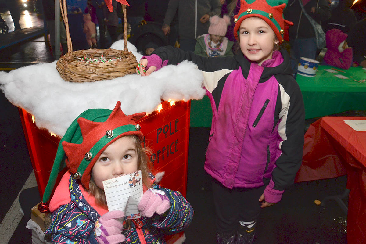 Amelia and Zoey were Santa's special helpers at the Brookswood Night of Lights. They helped kids write letters to Santa. (Heather Colpitts/Langley Advance Times)