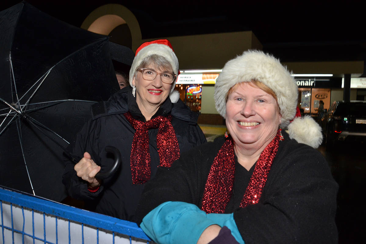 The Peace Arch Chorus performed during Brookswood Night of Lights. Members Fern Dunlop and Mary Wulfhurst helped make the evening merry. (Heather Colpitts/Langley Advance Times)