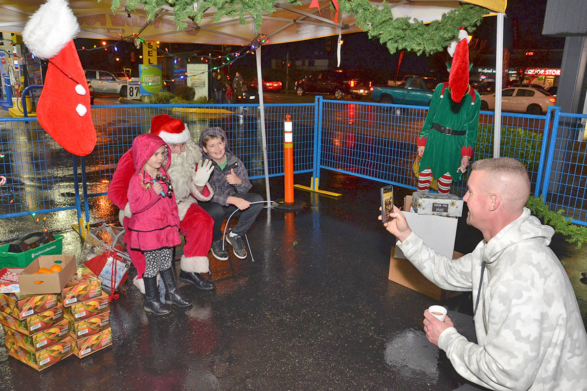 Lots of people turned out to Brookswood Night of Lights to enjoy visits with Santa, live entertainment, treats, crafts, raffles and more. (Heather Colpitts/Langley Advance Times)