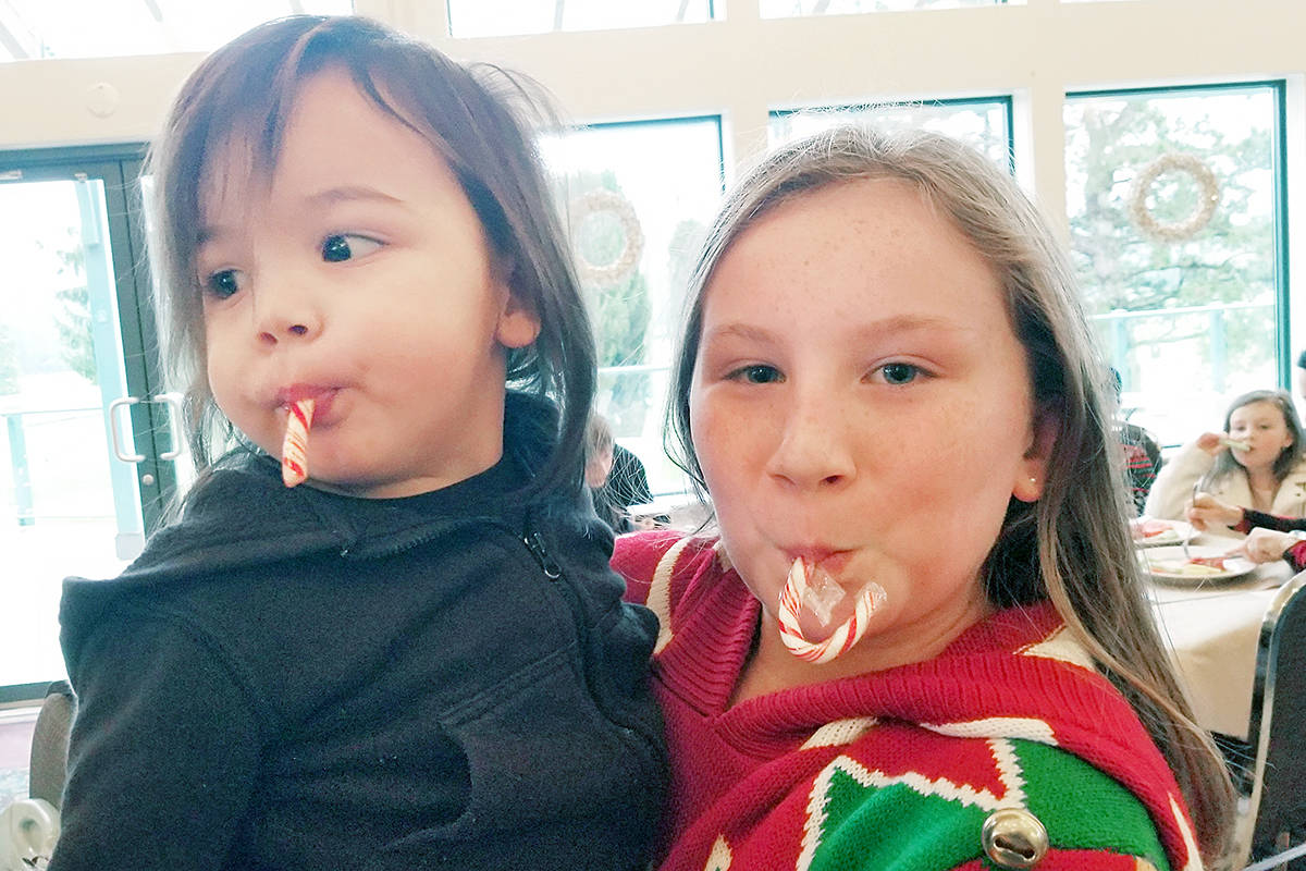 Some of the younger attendees at the annual Inclusion Langley Society Child Development Services Christmas breakfast with Santa at the Langley Golf and Banquet centre on Saturday (Dec. 7). (Dan Ferguson/Langley Advance Times)