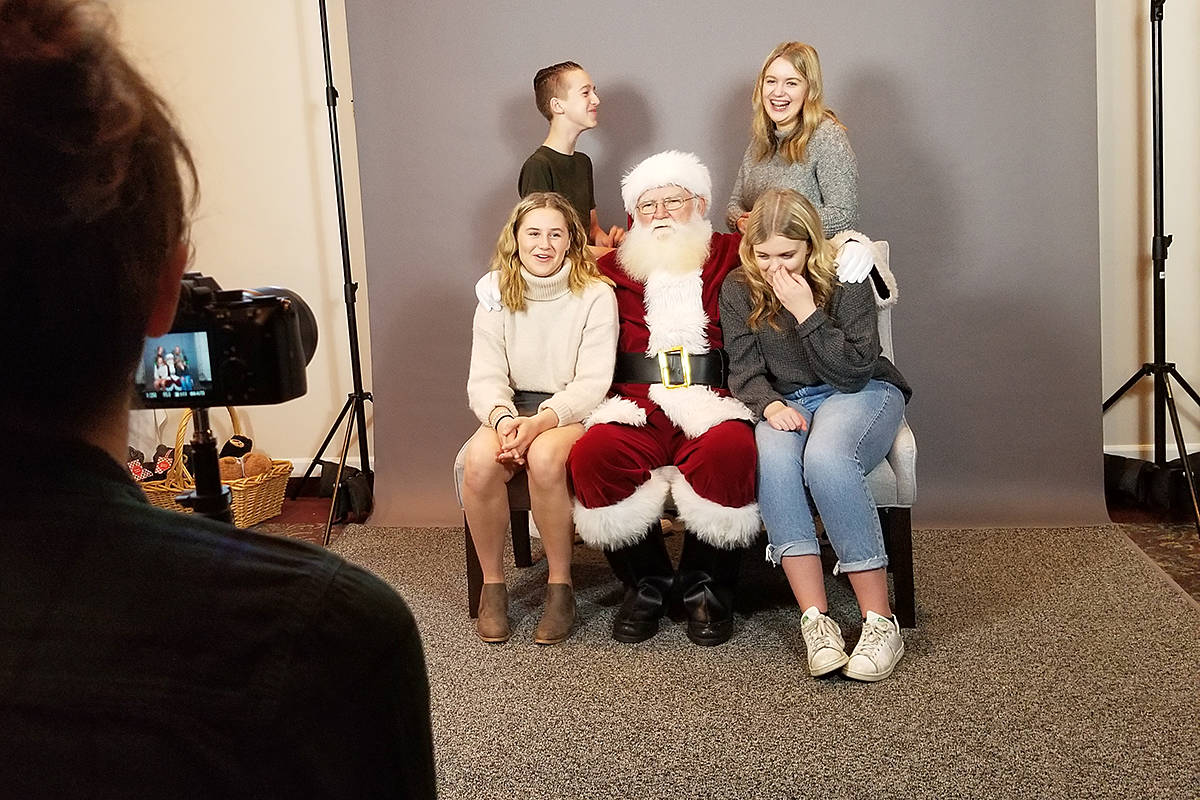 Pictures with Santa were part of the experience at the Inclusion Langley Society Child Development Services Christmas breakfast with Santa at the Langley Golf and Banquet centre on Saturday (Dec. 7). (Dan Ferguson/Langley Advance Times)