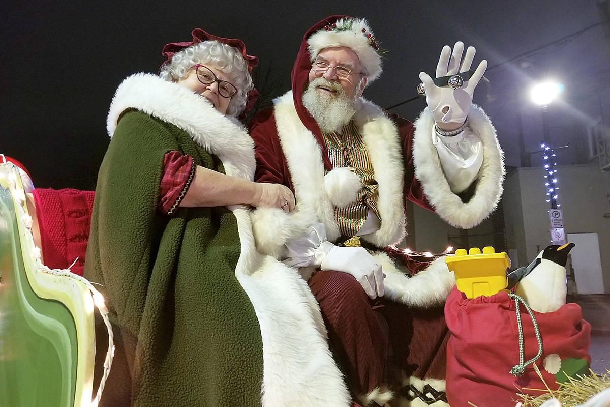 Santa and Mrs. Claus at the Magic of Christmas parade in Langley City Saturday night (Dec. 7). (Dan Ferguson/Langley Advance Tines)