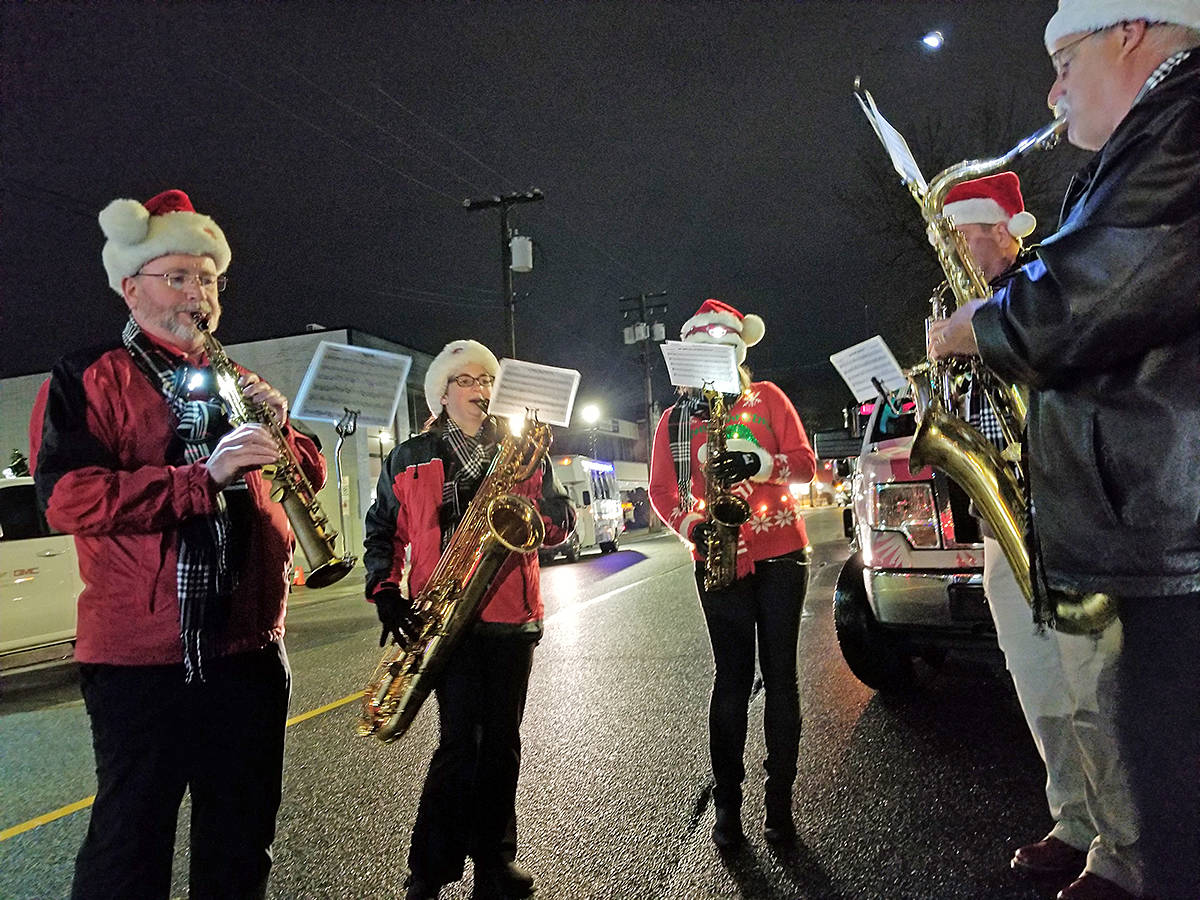 A band warmed up before the start of the annual Magic of Christmas parade in Langley City on Saturday night. (Dan Ferguson/Langley Advance Times)