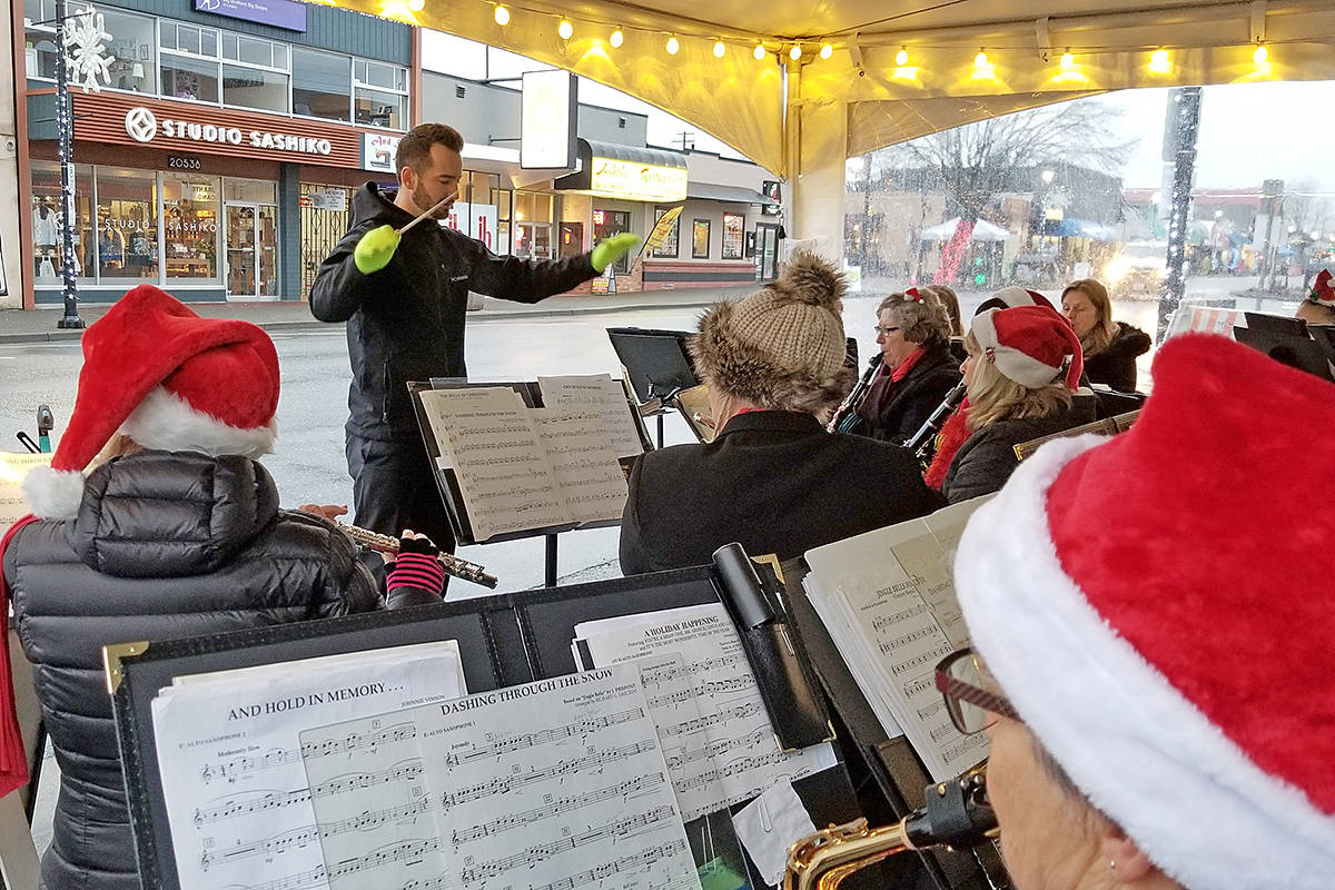 The South Fraser Community Band performed Christmas classics before the the annual Magic of Christmas parade in Langley City got underway Saturday night. (Dan Ferguson/Langley Advance Times)