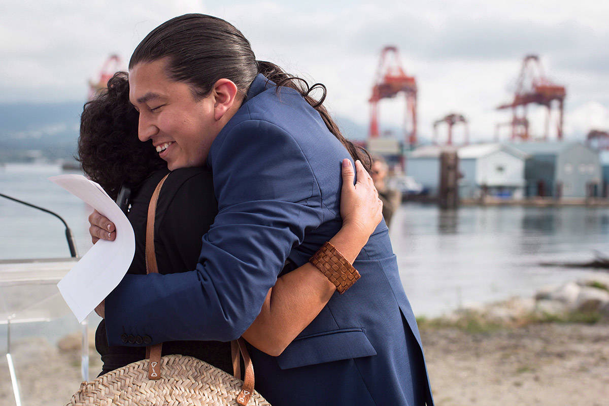 Khelsilem (Dustin Rivers), right, elected councillor and spokesperson for Squamish Nation, embraces Tsleil-Waututh Nation councillor Charlene Aleck in celebration before First Nations leaders respond to a Federal Court of Appeal ruling on the Kinder Morgan Trans Mountain Pipeline expansion, during a news conference in Vancouver on August 30, 2018. THE CANADIAN PRESS/Darryl Dyck