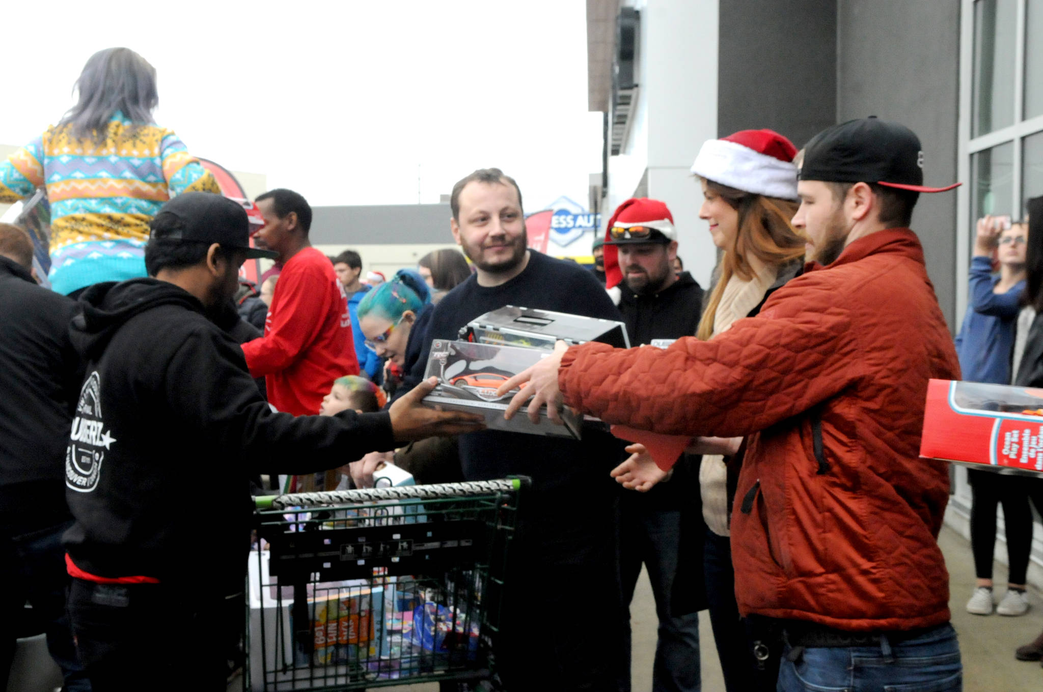 VIDEO: European car enthusiasts donate $2000 and truckloads of toys to Langley Christmas Bureau