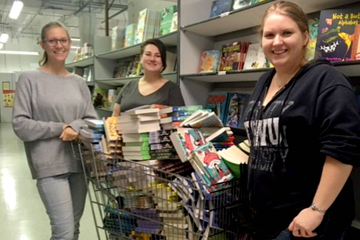 Organizers purchase new books for annual Wrap-A-Read program. Books will be handed out to Langley children registered with the Christmas bureau. (Langley Literacy Network Facebook)