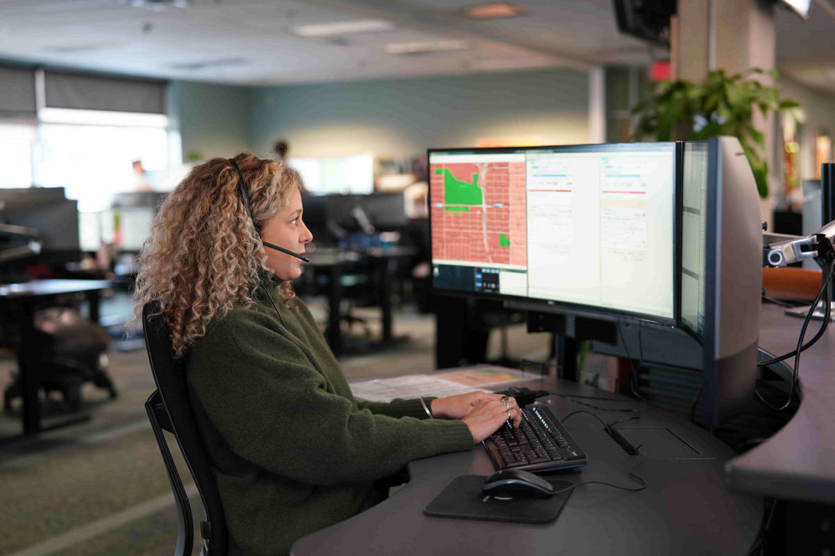 E-Comm 911 call taker Madison Sheane says knowing your building or home address, the streets or landmarks you are near and your compass directions helps her ensure you get the help you need as quickly as possible. (E-Comm 911 photo/Submitted)