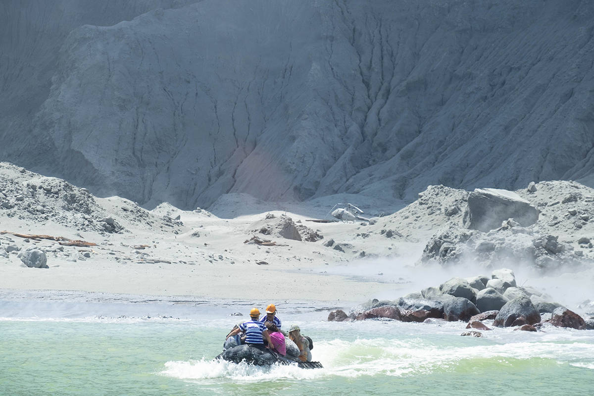 White Island tour operators rescue people after a deadly volcanic eruption off the coast of New Zealand Monday, Dec. 9, 2019. Michael Schade took these photos, tweeting that he and his family got off the island only 20 minutes before the eruption. (Michael Schade/Twitter photo)