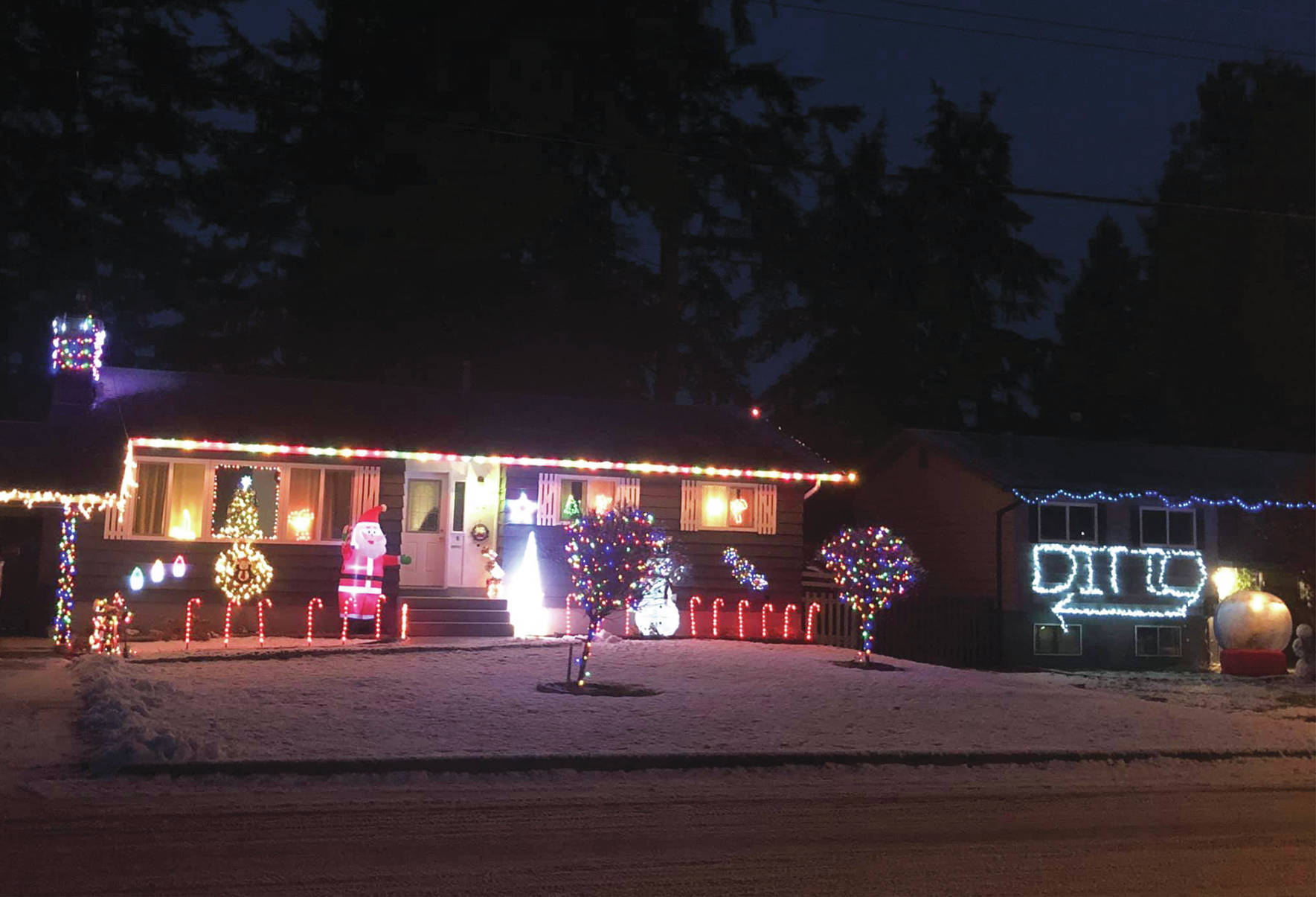 PHOTOS: Competitive Christmas light display takes sarcastic turn in Princeton