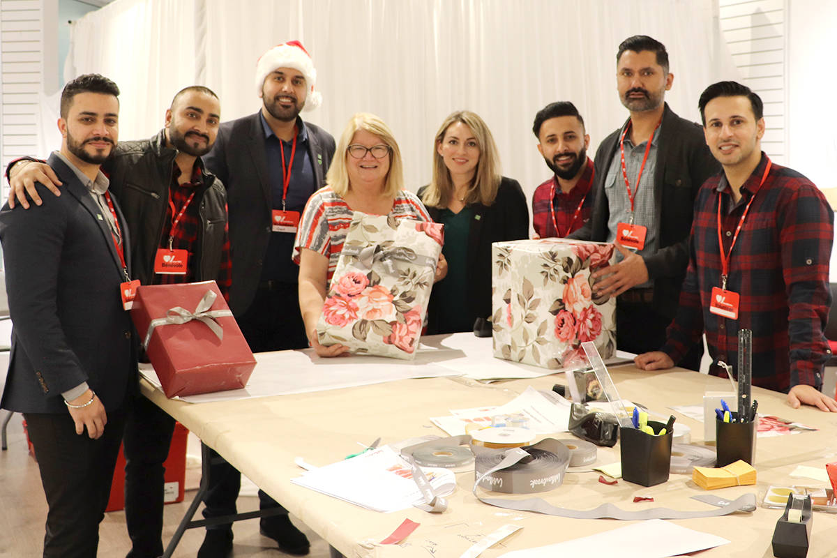 Su Brock (centre left) with the Heart & Stroke foundation wraps gifts with the TD Canada Trust Fraser Valley mobile mortgage team at Willowbrook mall. (Joti Grewal/Langley Advance Times)