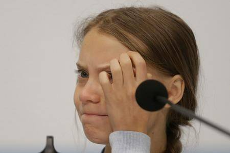 Climate activist Greta Thunberg takes part in a news conference at the COP25 climate summit in Madrid, Spain, Monday, Dec. 9, 2019. Thunberg is in Madrid where a global U.N.-sponsored climate change conference is taking place. (AP Photo/Andrea Comas)