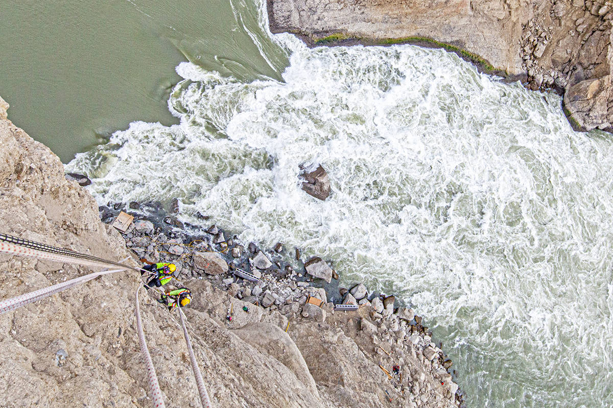 A photo of workers scaling the cliffs above the Big Bar Slide on the Fraser River. (Trevor Mack photo)
