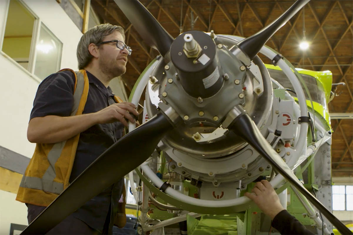 Workers get the first-ever Harbour Air all-electric seaplane ready for flight. (YouTube)