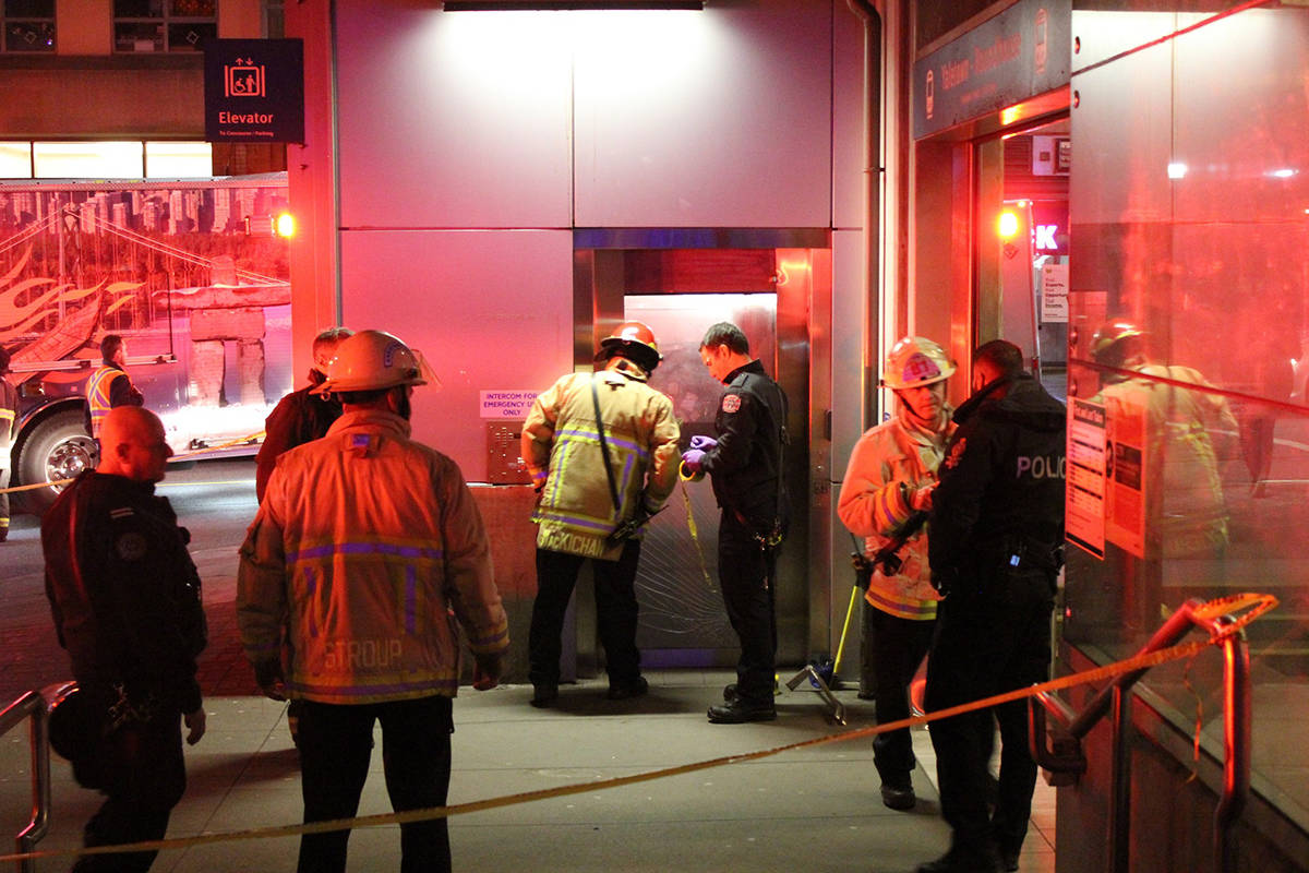 Vancouver firefighters and Metro Vancouver Transit Police work to extricate a man in a mobility scooter who fell down an elevator shaft at the Yaletown SkyTrain Station on Monday, Dec. 9, 2019. (Ryan Stelting)