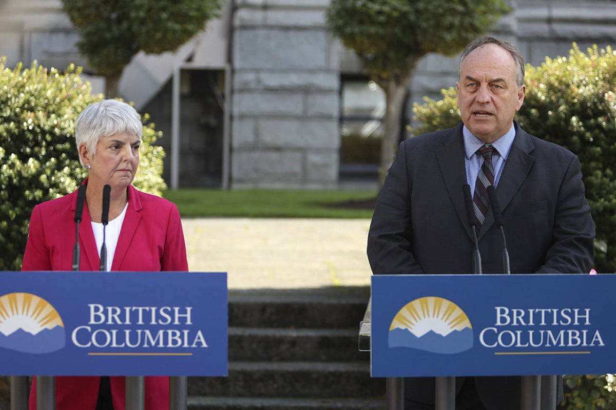 B.C. Finance Minister Carole James and B.C. Green Party leader Andrew Weaver announce rate reduction for Canadian citizens paying new property tax on homes empty six months of the year or more. B.C. legislature, Sept. 9, 2018. (Tom Fletcher/Black Press)