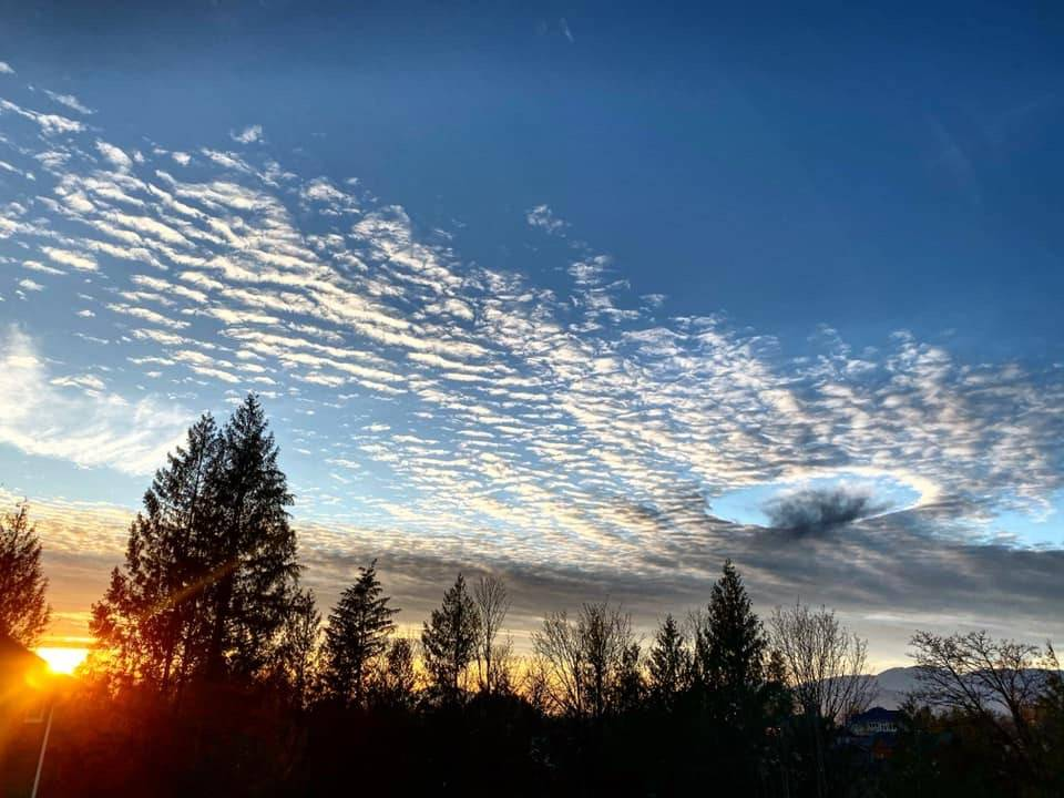 """Lauren Mitchell posted this photo so-called """"fallstreak cloud"""" or """"hole punch cloud,"""" formally known as a cavum, that appeared over Chilliwack on Dec. 9, 2019. (Facebook)"""