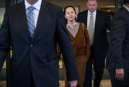 Huawei chief financial officer Meng Wanzhou, who is out on bail and remains under partial house arrest after she was detained last year at the behest of American authorities, leaves B.C. Supreme Court during a lunch break from a hearing, in Vancouver, on Thursday October 3, 2019. (THE CANADIAN PRESS/Darryl Dyck)