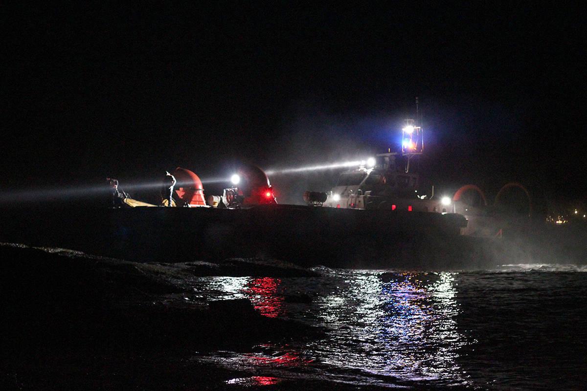 A hovercraft scans the shore along DeCourcy Drive on Gabriola Island following a plane crash Tuesday night. (Greg Sakaki/The News Bulletin)