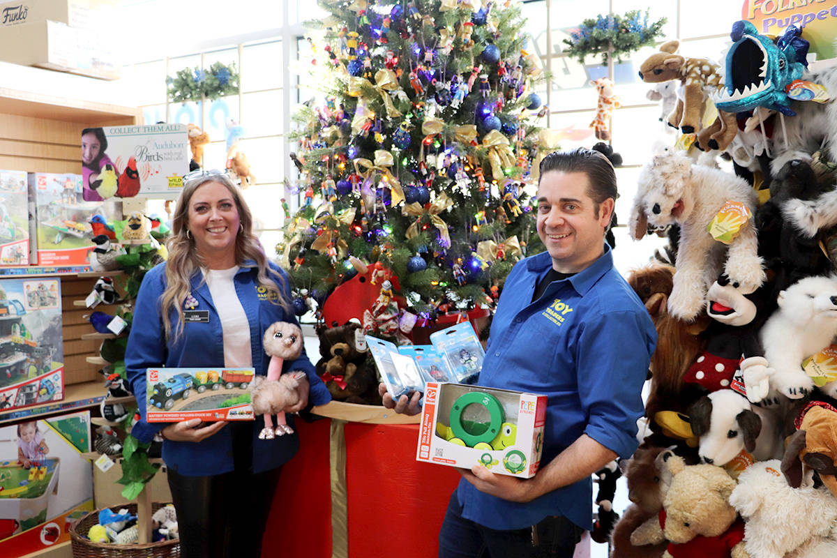 Lori Heppner and Matthew Purdy share the top toys this holiday season. (Joti Grewal/Langley Advance Times)