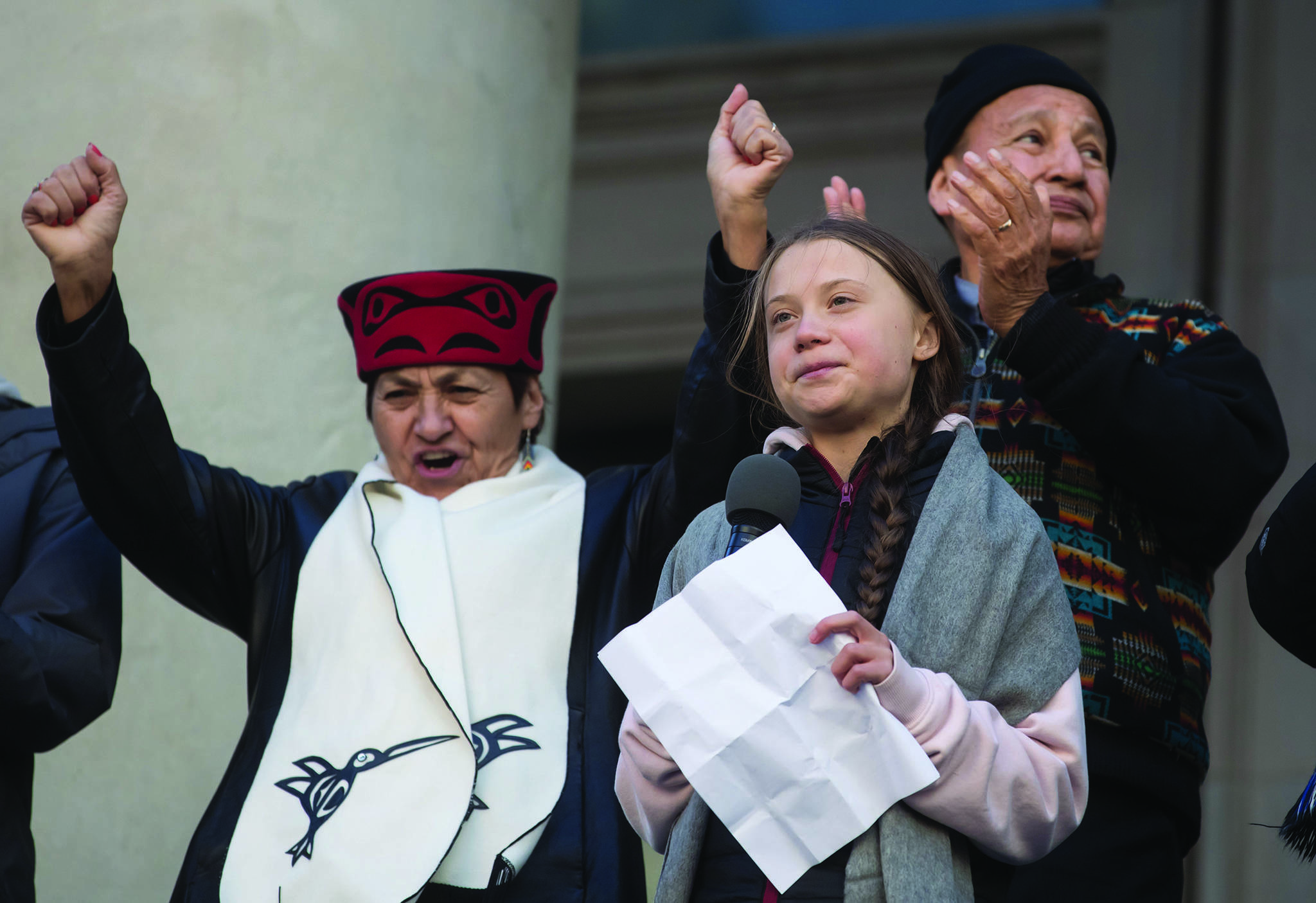 Swedish environmental activist Greta Thunberg, front right, is applauded by Grand Chief Stewart Phillip and cheered by his wife Joan Phillip as she addresses a student-led climate change rally after participating in a march, in Vancouver, on Friday October 25, 2019. THE CANADIAN PRESS/Darryl Dyck