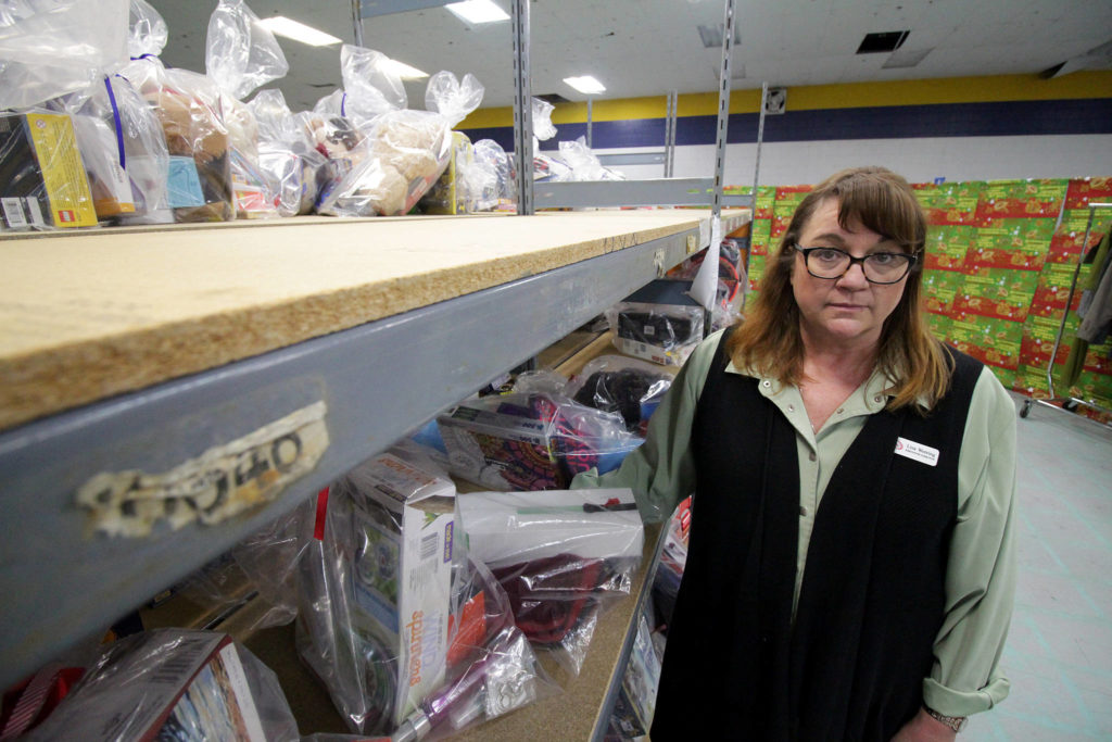 Lisa Werring, executive director of the Surrey Christmas Bureau, in front of the mostly empty shelves for teenagers. The bureau was broken into early Wednesday morning, Dec. 11. (Photo: Lauren Collins)