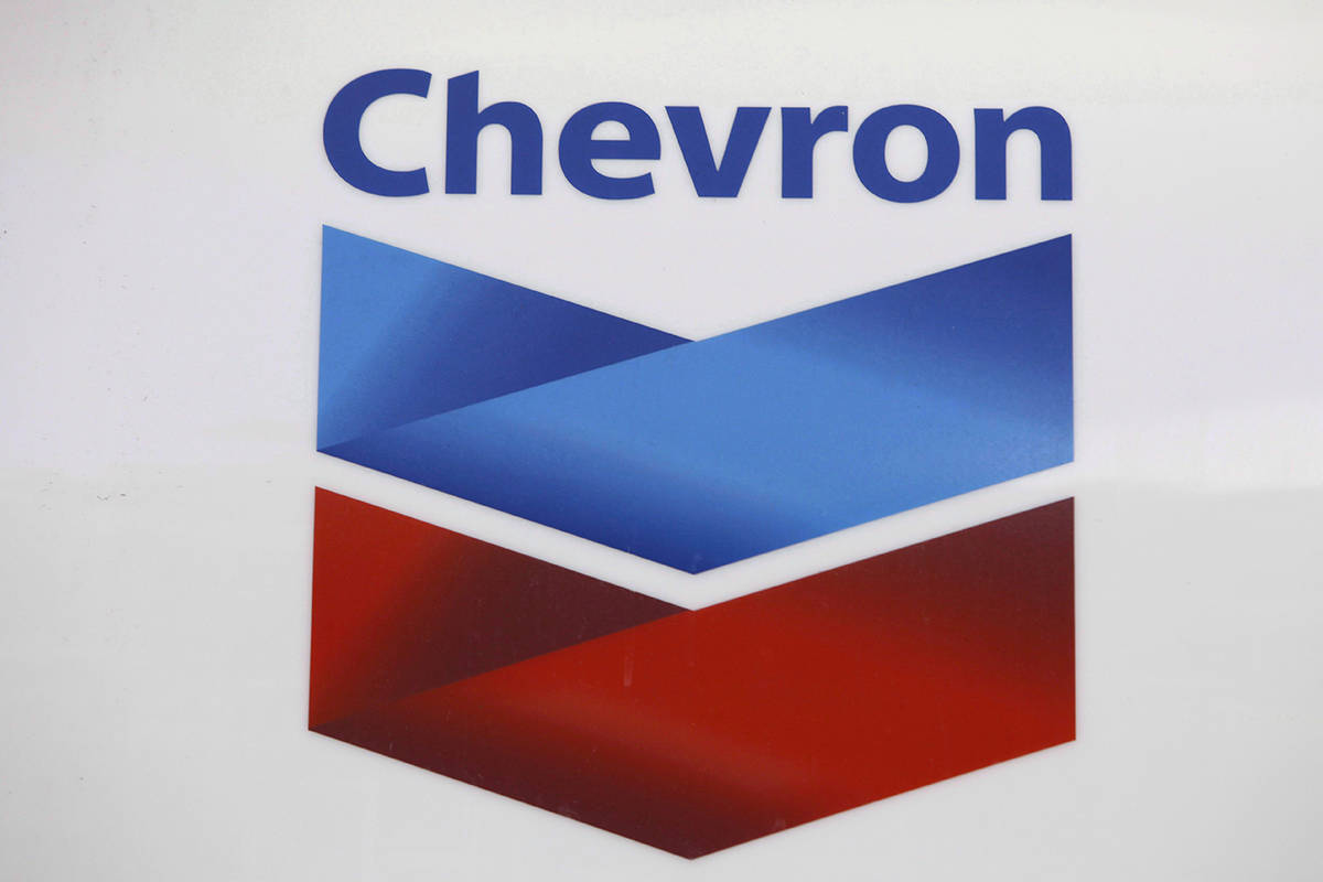 A Chevron logo appears at a gas station in Miami on July 25, 2011. The Canada Energy Regulator says it has approved an application from Chevron Canada to export natural gas from the Kitimat LNG project for a term of 40 years over environmental opposition. THE CANADIAN PRESS/AP, Lynne Sladky