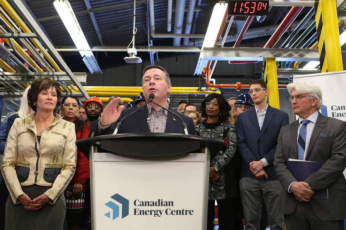 Alberta Premier Jason Kenney, centre, addresses attendees at a press conference to announce the launch of the Canadian Energy Centre at SAIT in Calgary, Alberta Wednesday, December 11, 2019. Energy Minister Sonya Savage (left) and Tom Olsen, Managing Director of the Canadian Energy Centre, look on. Kenney has officially opened the province's energy war room to fight what he calls a campaign of lies about the province's energy industry. THE CANADIAN PRESS/Greg Fulmes