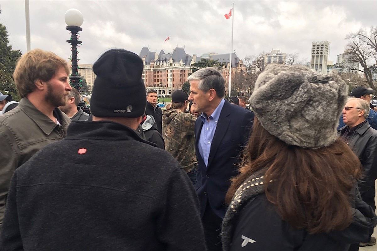 B.C. Liberal leader Andrew Wilkinson speaks with unemployed forest industry contractors attending rally at B.C. legislature, Dec. 11, 2019. (Tom Fletcher/Black Press)