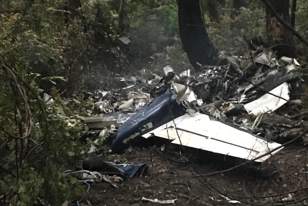 """The scene of a small plane crash on Gabriola Island, B.C., is shown on Wednesday, Dec. 11. A plane that one witness describes as crashing in a """"huge explosion"""" that left multiple people dead in British Columbia has been identified as a twin-engine propeller aircraft. THE CANADIAN PRESS/Paolo Gastaldello"""