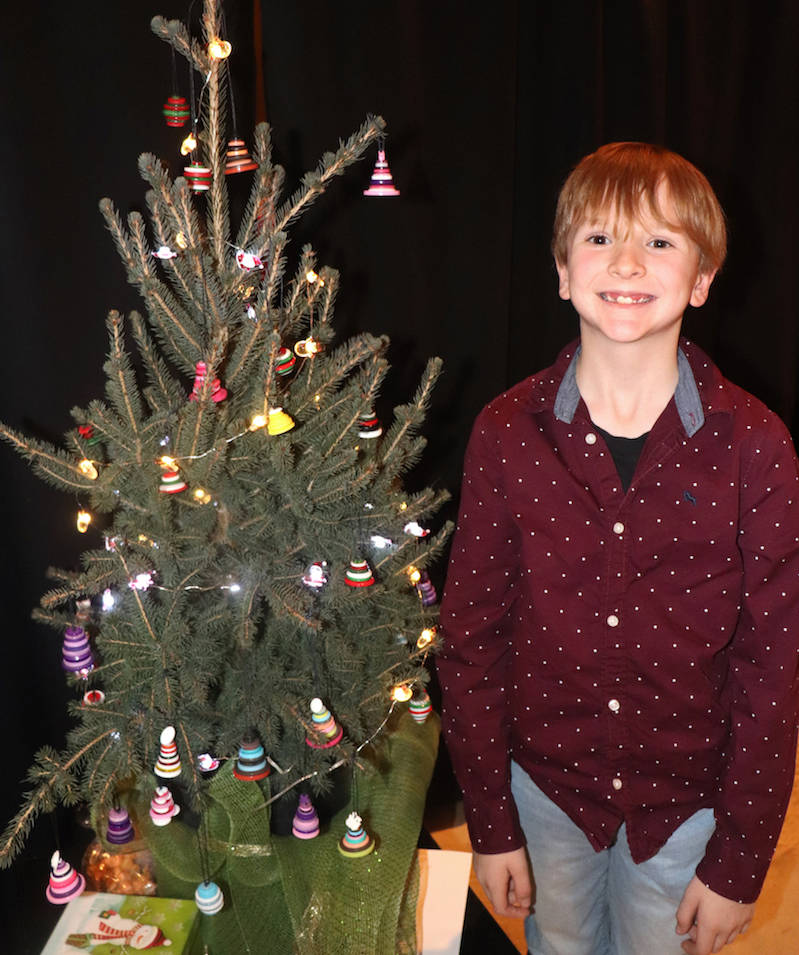 Zachary Vanderwerf, 8, made tree ornaments which he sold enough to send a kid to camp for free this summer. (Sarah Grochowski photo)
